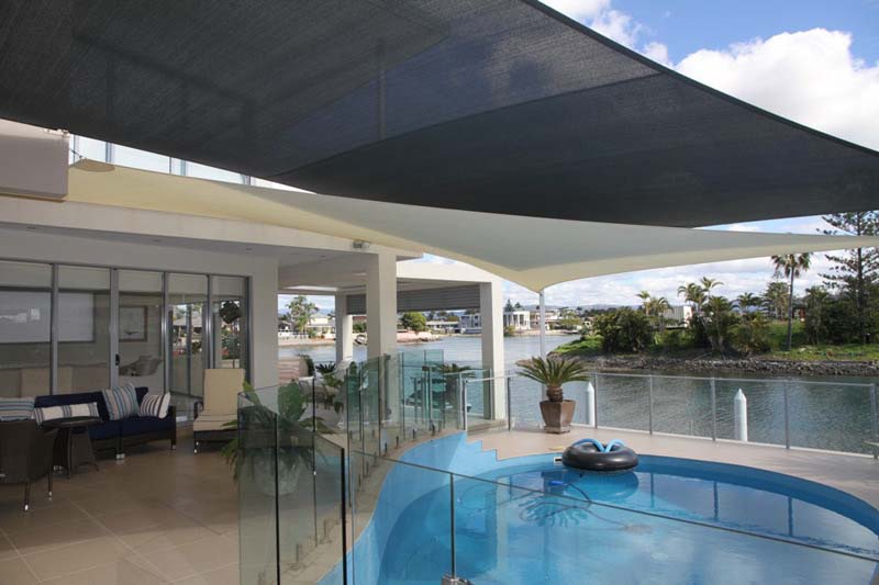shade sails over swimming pool areas to extend usibility