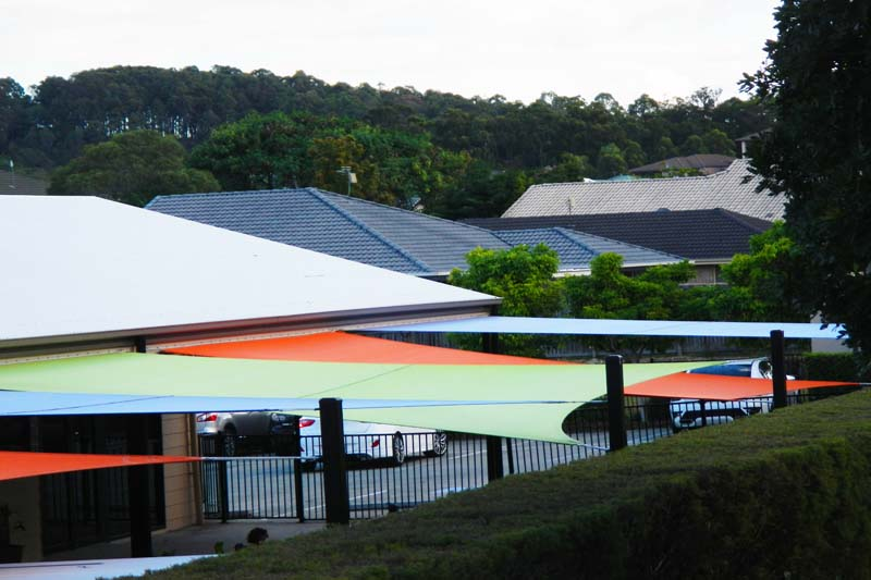 colourful shade sails make the building look good