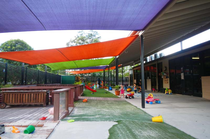 playground at a child care centre with shade sail sun protection