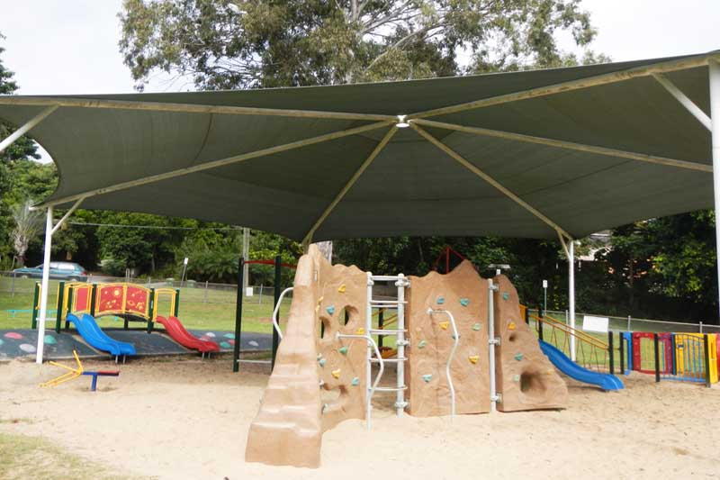 large octagonal shade sail over a playground as a school